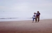On the beach with Evelyn Robinson and her son Ferg